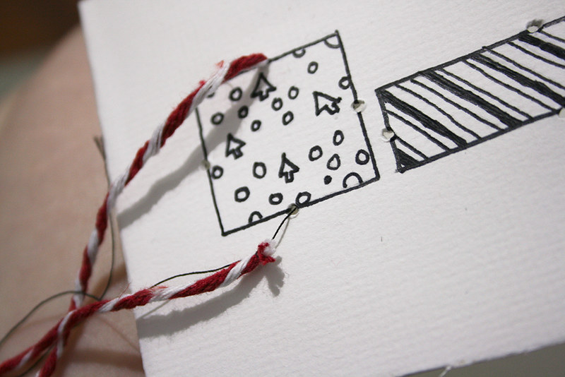 Christmas cards - Threading the twine through