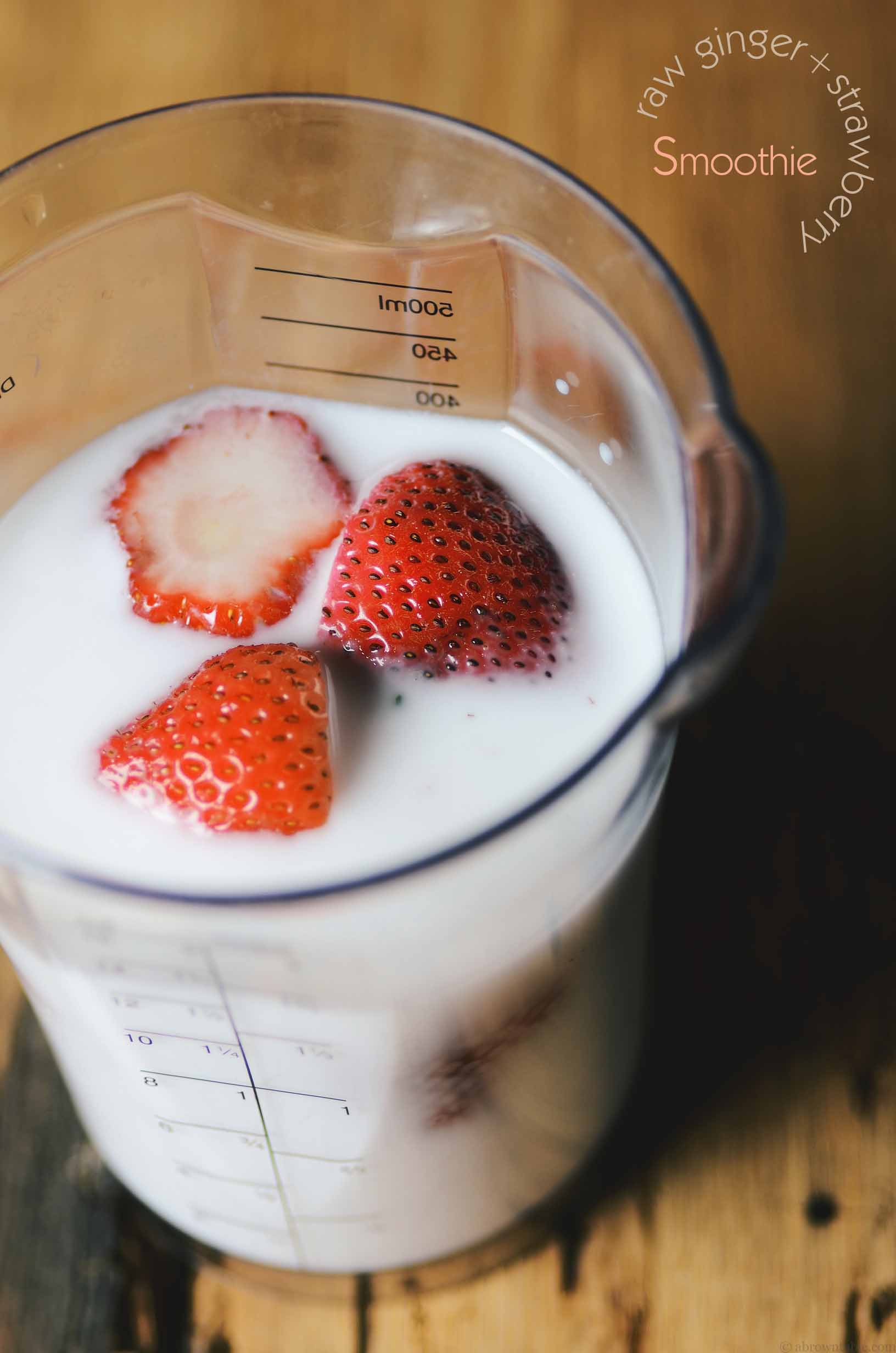 floating strawberries on coconut milk