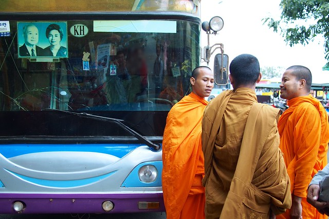 monks in front of a coach, Phnom Penh, Cambodia