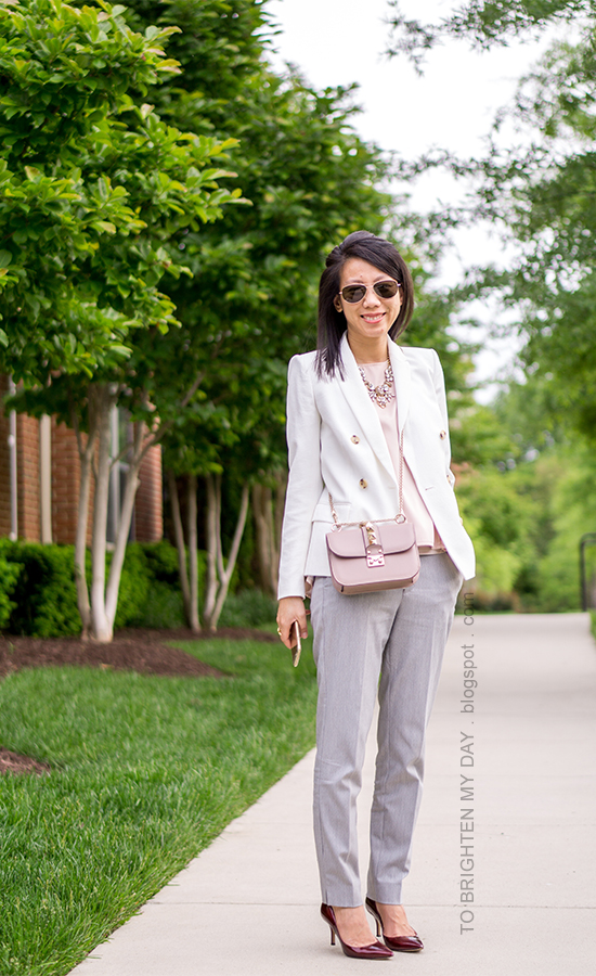 white blazer, pink peplum top, gray pants, nude crossbody bag, burgundy pumps