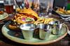 Burger w/ pepper jack, pico de gallo, avocado sour cream and crunchy tortillas - Table 9