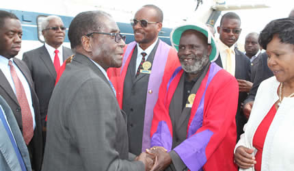 President Mugabe is welcomed by Chief Chiduku while Chief Zimunya and Cde Oppah Muchinguri look on in Mutare on May 10, 2013. ZANU-PF is preparing for harmonized elections in late June of this year. by Pan-African News Wire File Photos