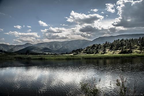 trees lake mountains water clouds contrast landscape colorado hills larkspur