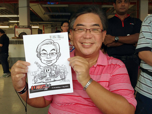 caricature live sketching for NTUC U Grand Prix Experience 2013 - 12