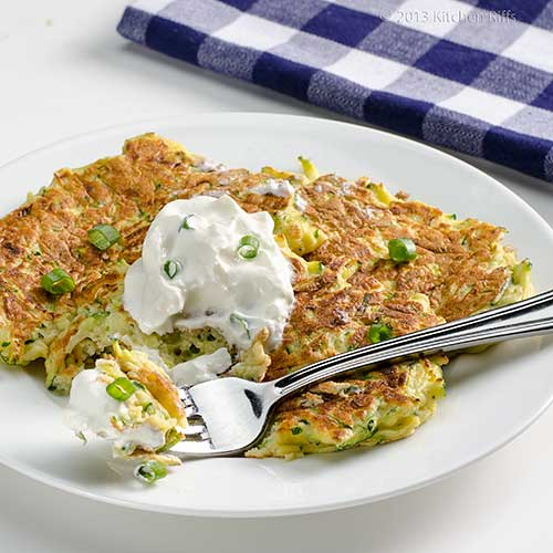 Zucchini Pancakes with sour cream garnish