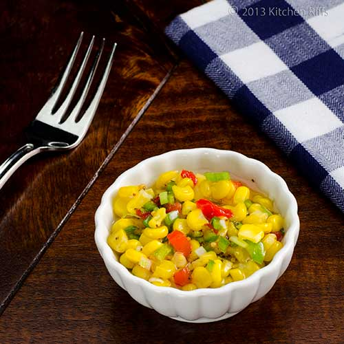Quick Corn Relish in ramekin with fork and napkin in background