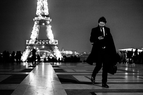 Business man phoning back to Eiffel Tower, Paris by Photos-Change-The-World
