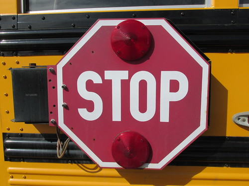 The electric flashing safety stop sign flag on an AGF Transportation Company school bus.  Summit Illinois.  March 2014. by Eddie from Chicago
