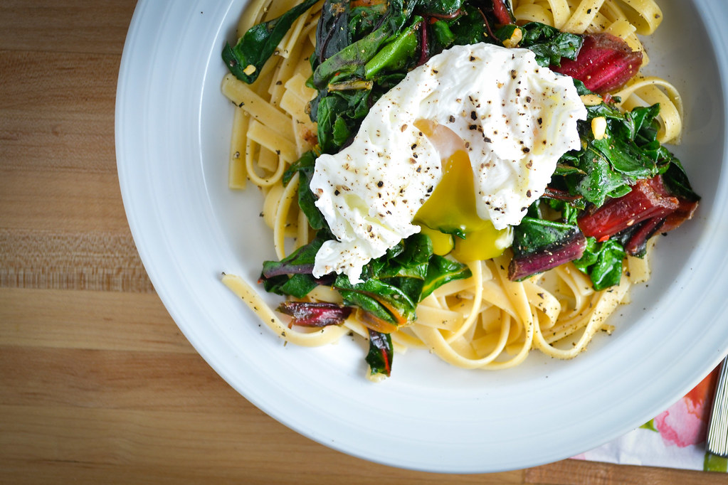 wilted greens and pasta with a poached egg in a browned lemon butter ...
