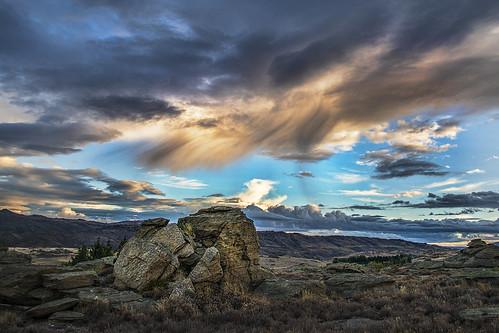 sunset rain rock clouds near central boulder alexandra maybe nz otago tor coming