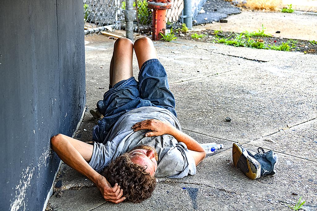 Homeless man across the street from Walmart--Pennsport