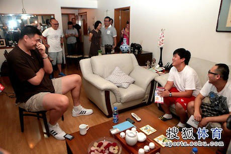 June 27th, 2013 - Yao Ming visits with the winners of a ticket lottery