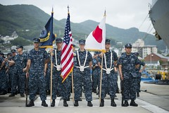 Sailors in a color guard stand at parade rest before the start of a hull-swap ceremony between USS Ashland (LSD 48) and USS Tortuga (LSD 46), Aug. 23 in Sasebo. (U.S. Navy photo by Mass Communication Specialist Seaman Scott Youngblood)