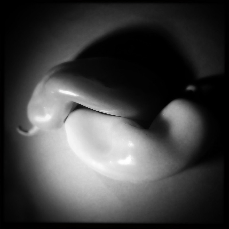 A Hipstamatic film/lens study with peppers.              Tools used: #photojojo wide/macro lens #Sima video lamp on #joby tripod