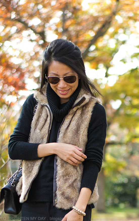 fur vest, black cowlneck sweater, bracelets