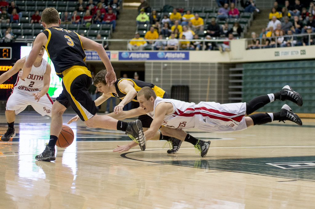 South Webster's Levi Cook and Paint Valley's Quinten Sparks get on the floor for a loose ball.