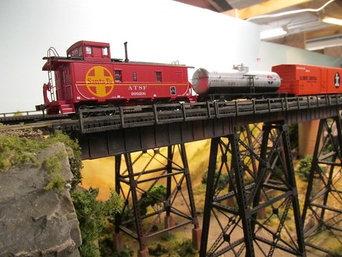 A 1970's era Atchison, Topeka & Santa Fe Railroad freight train crossing the tall steel trestle. by Eddie from Chicago