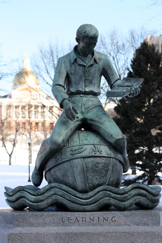 Boston Common Learning statue with dome in background