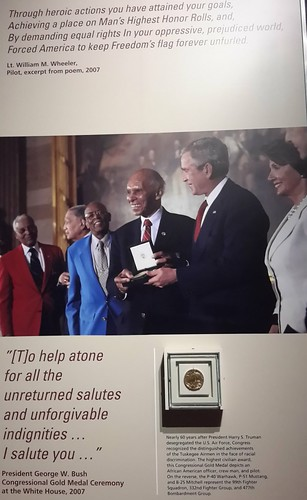The Tuskegee Airmen receiving a Congressional Gold Medal from President George W. Bush