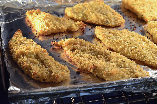 Breaded fish cooking in the oven.