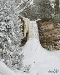 Winter at Munising Falls, My wife Shelly is standing near the Ice Column by Michigan Nut