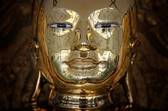 The eyes of the golden Buddha mark its intentions
