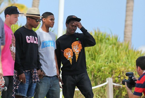 Pharrell on Miami Beach fimling with some skaters