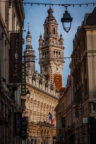 Lille clocktower, as seen through narrow streets,