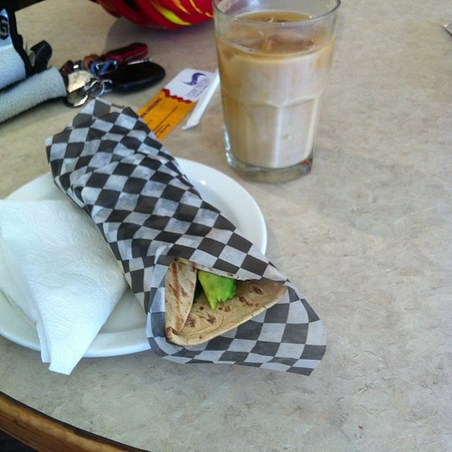 Turkey grilled sandwich and iced coffee at Gracious Goods. #yegfood by raise my voice