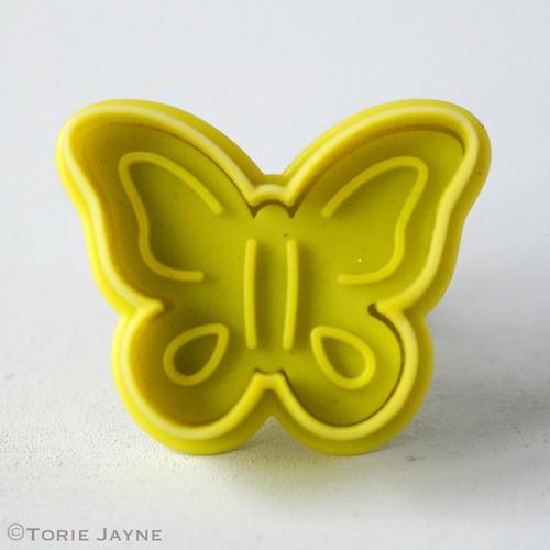 Butterfly plunge cutter