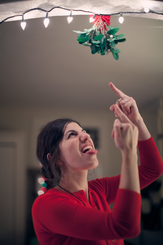 Emily flipping off the mistletoe