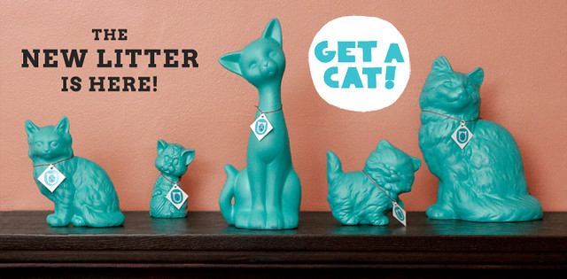 a collection of teal cats