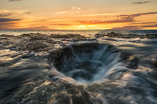 Sunset at Thor's Well in OR (photo from Hidden Gems of the Western United States by Daniel Gillaspia)