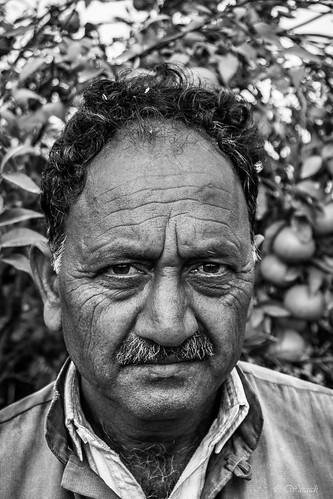 poverty street family pakistan portrait blackandwhite bw white man black landscape eyes village candid streetphotography streetscene stare worker farmer punjab punjabi hardworking portraitphotography wjahatwaraich villagedweller
