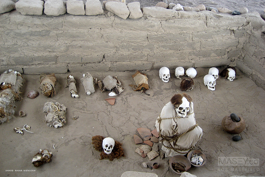 Exploring the excavated cemetery pits of Chauchilla, Peru.