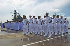 U.S. Navy and Royal Thai Navy sailors stand at parade rest during the closing ceremony for the Thailand portion of Cooperation Afloat Readiness and Training (CARAT) exercise 2013. (U.S. Navy photo by Mass Communication Specialist 3rd Class Amanda S. Kitchner)
