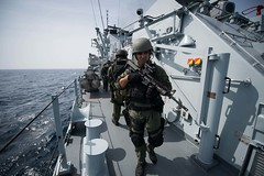 In this file photo, a visit, board, search and seizure team from Surface Warfare Detachment 1, embarked aboard the littoral combat ship USS Freedom (LCS 1) searches and secures the Royal Malaysian Navy guided-missile frigate KD Jebat (FFG 29) during a Cooperation Afloat Readiness and Training (CARAT) Malaysia 2013 exercise in the South China Sea in June. (U.S. Navy photo by Mass Communication Specialist 3rd Class Karolina A. Oseguera)