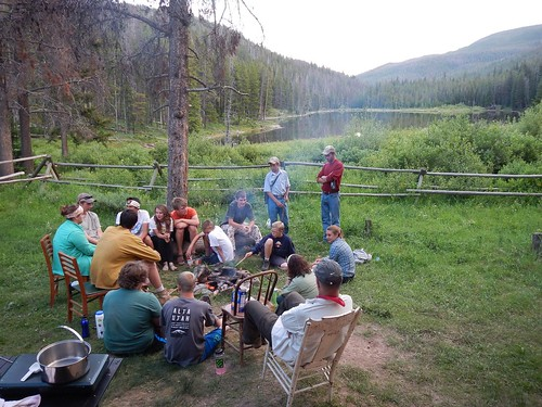 After a long day of monitoring in the Scapegoat Wilderness, students sit around the campfire at Webb Lake Ranger Station. Forest Service photo.