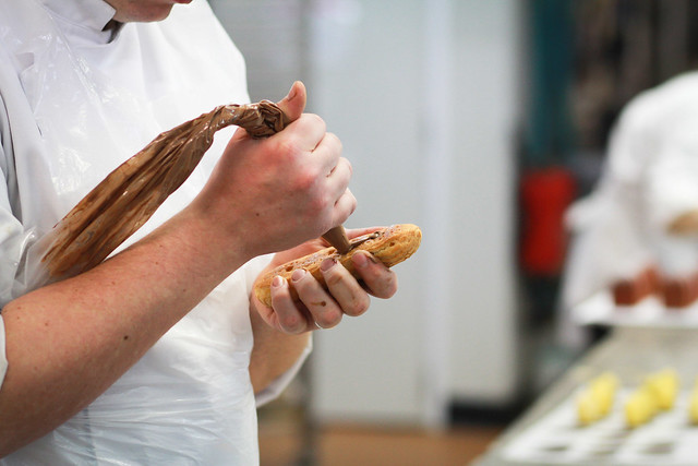 Fauchon pastry kitchens - filling the éclairs