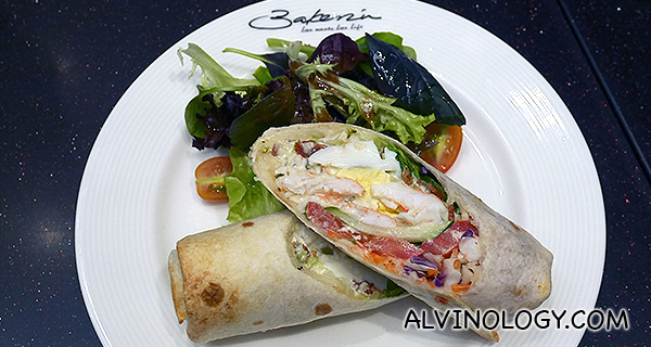 Caesar Prawn Wrap (S$19.50) - Grilled tortilla wrap, prawns, crispy bacon, hard-boiled egg, baby romaine, mixed greens, tomatoes, cucumber and caesar dressing, served with mesclun in house dressing.