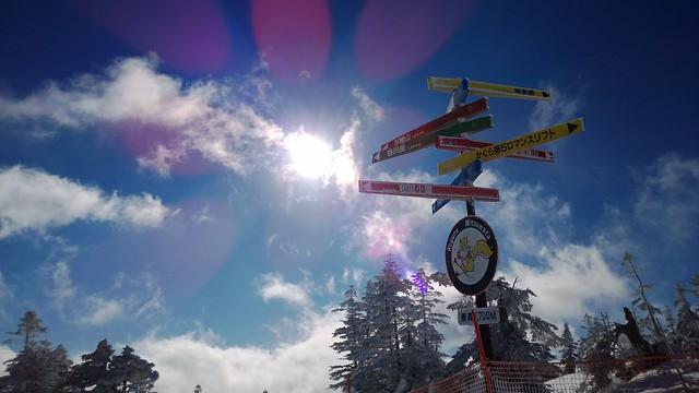 Blue sky and sun shine over the white mountain