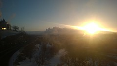 The sun triumphantly clears the refineries, lighting the river valley and glinting off the windows of the Hotel Mac #yeg