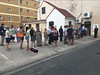 Gibraltar residents wait in line to cast their vote
