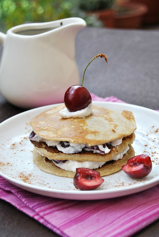Rye flour pancakes with ricotta and cherries