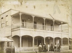 Unidentified men gathered outside the School of Arts Building, Charters Towers