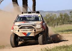 auto racing(0.0), compact sport utility vehicle(0.0), rallycross(0.0), world rally championship(0.0), automobile(1.0), automotive exterior(1.0), rallying(1.0), racing(1.0), vehicle(1.0), sports(1.0), dirt track racing(1.0), off road racing(1.0), motorsport(1.0), off-roading(1.0), rally raid(1.0), off-road vehicle(1.0), bumper(1.0),