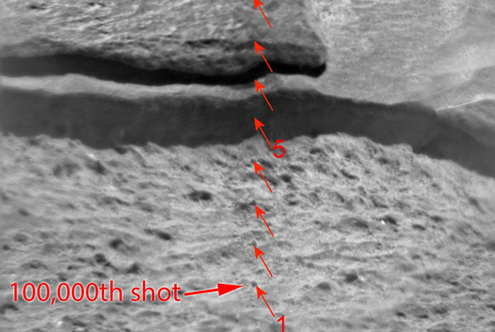 "This figure is a ChemCam Remote Micro Imager (RMI) image of the target ""Ithaca"".  The image is a mosaic of three separate images taken on Sol 439, with the scale as shown.  The image shows the scars from the ten LIBS points labeled from point 1 to point 10.  One of the 30 shots at point no. 1 was the 100,000th firing of the ChemCam laser!  The distance to the target from the ChemCam telescope at the top of the mast was 4.04 m.  The vertical line of ten points taken by ChemCam on Ithaca, starts in a pitted lower coarser grained unit and crosses into a finer grained, smoother, upper unit.  The chemical composition appears to be very similar between units.  (Image credit: NASA/JPL-Caltech/LANL/CNES/IRAP)"