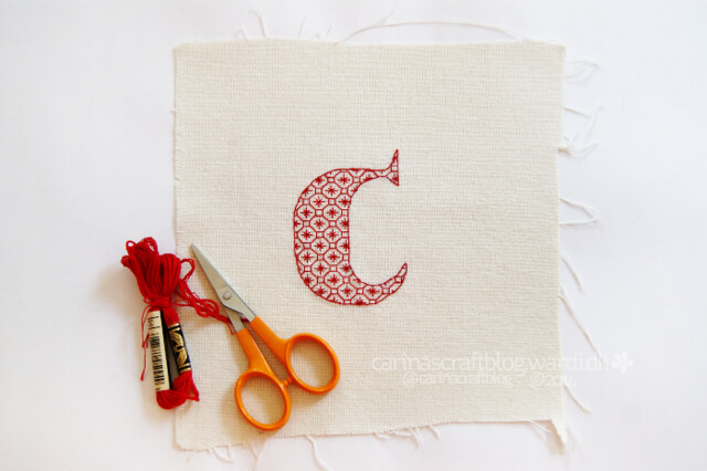 Letter C in red blackwork
