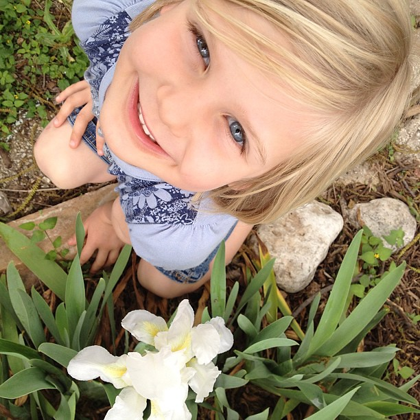I was taking a photo of our newly blooming iris, and Eleanor wanted to get in on the picture. She definitely makes a better photo! #nofilter #latergram #portrait
