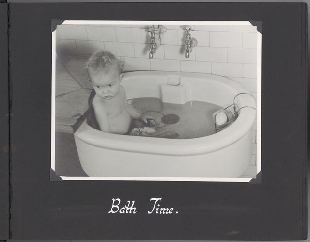 [Photograph of child during] bath time.